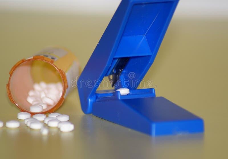 Taglierina della pillola immagine stock libera da diritti