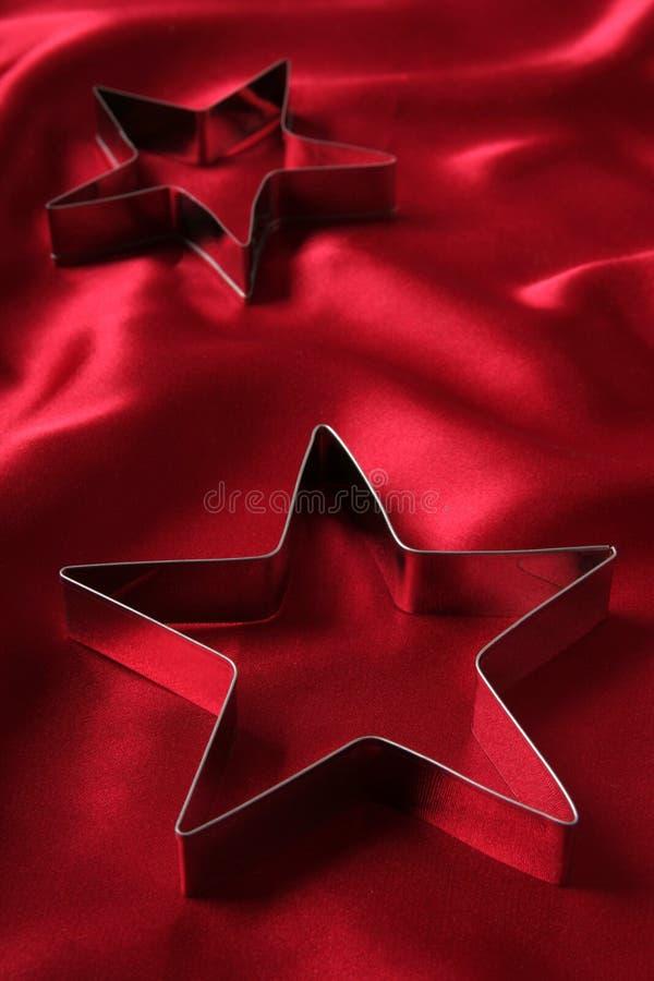 Taglierine a forma di stella del biscotto immagine stock