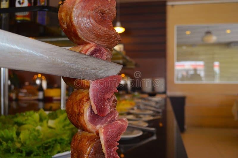 Taglio dell'Argentina del picanha in ristorante fotografie stock
