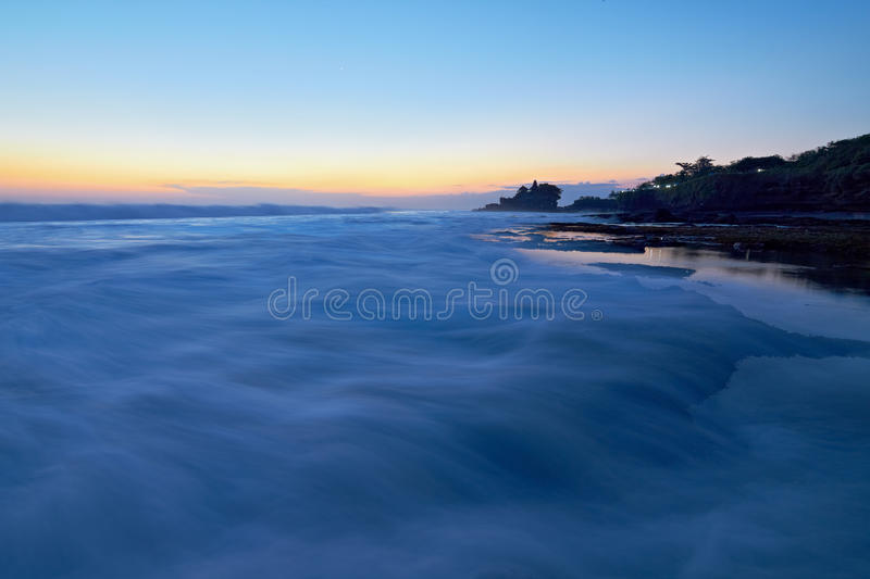 Download Tanah Lot Temple And Ocean Waves At Sunset Stock Image - Image of balinese, history: 26694133