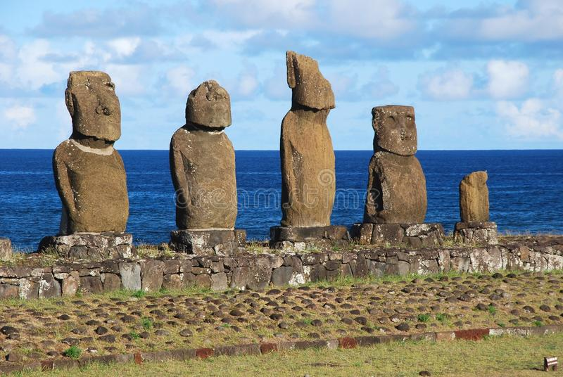 Tahai Ceremonial Complex archaeological site Rapa Nui - Easter Island. Tahai Ceremonial Complex, Easter Island, Giant stone statues Moai standing upon ceremonial royalty free stock images