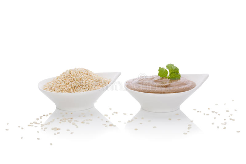 Tahini dip and sesame seeds. stock image