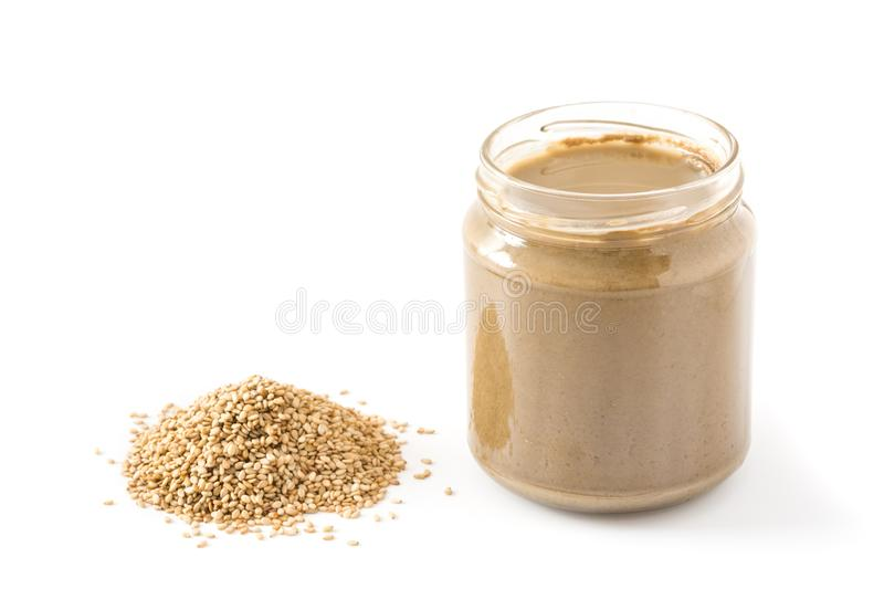 Tahini and sesame seeds isolated stock images