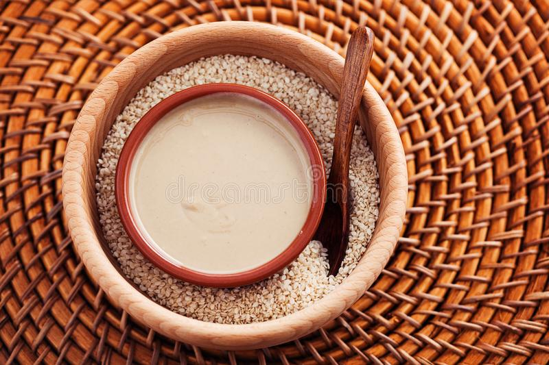 Tahini and sesame seeds royalty free stock image