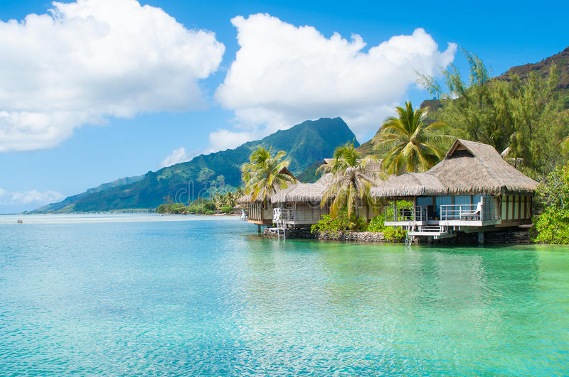 Tahiti Bungalows. Overwater bungalows in Tahiti, over blue green water royalty free stock photo