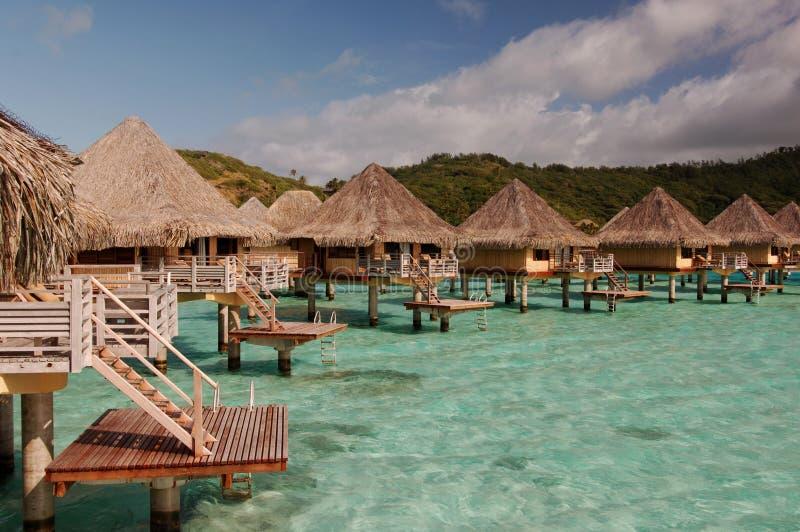 Tahiti Huts. Tahitian Bora Bora honeymoon suites royalty free stock images