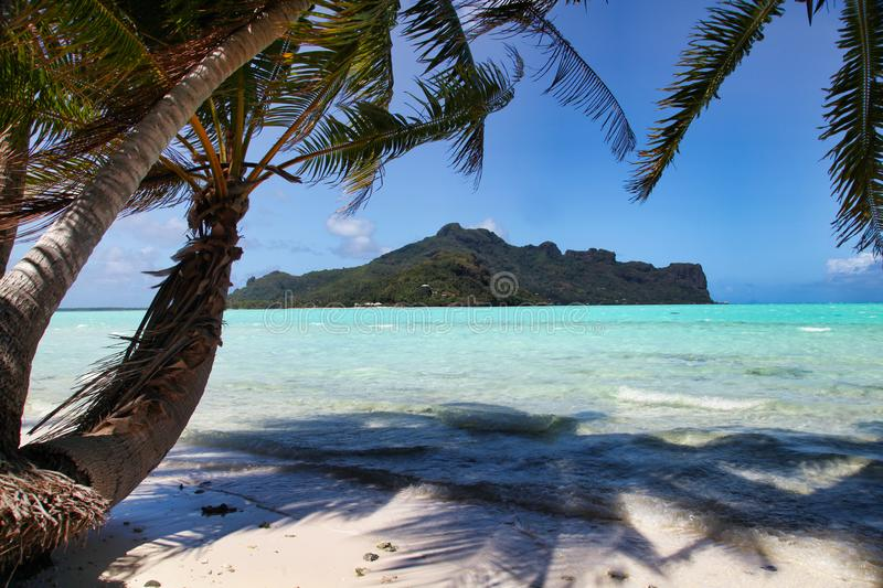 Maupiti beach, Tahiti island, French polynesia, close to Bora-Bora. Tahiti island, french polynesia, Tahiti Turk water and paradise island, view on the lagoon royalty free stock photography