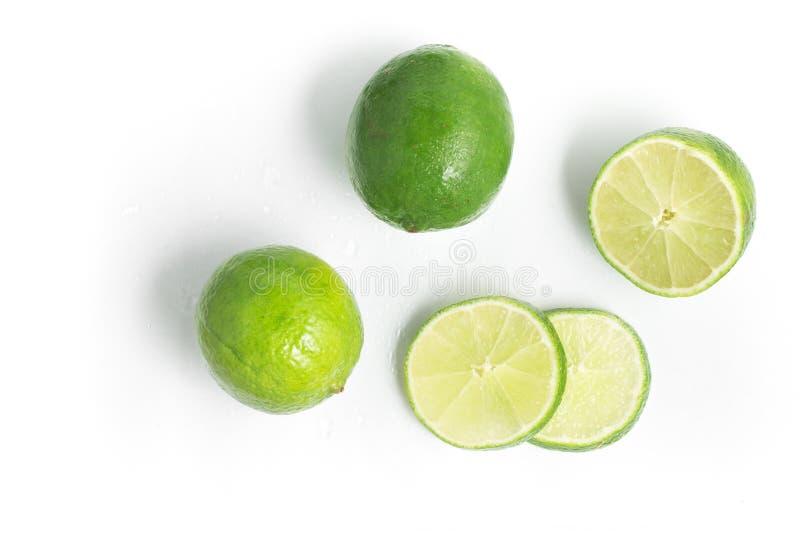 Tahiti Lemon Sliced. Tahiti Lemon Sliced over a white background stock photo
