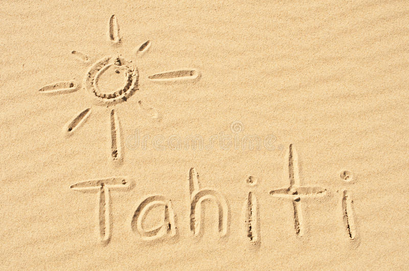 Tahiti in the Sand. A picture of the sun and the word Tahiti drawn in the sand royalty free stock images