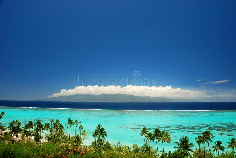 Tahiti view from Moorea. French Polynesia. Moorea is a high island in French Polynesia, part of the Society Islands, 17 km northwest of Tahiti. Tahiti is the stock photo