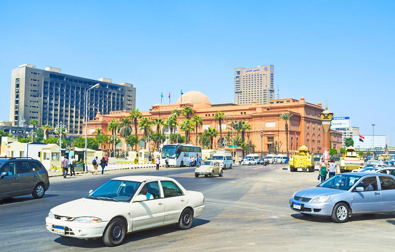 The Tahrir Square. CAIRO, EGYPT - OCTOBER 9, 2014: The Midan Tahrir with the chaotic traffic, army Republican Guard tanks, protecting the safety, and Egyptian royalty free stock photos