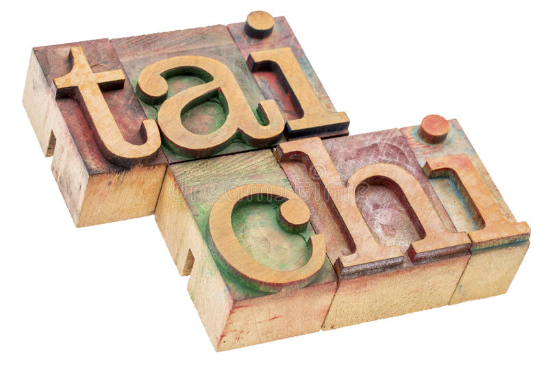 Tai chi in letterpress wood type. Tai chi - Chinese martial art - isolated word abstract in letterpress wood type blocks royalty free stock photos