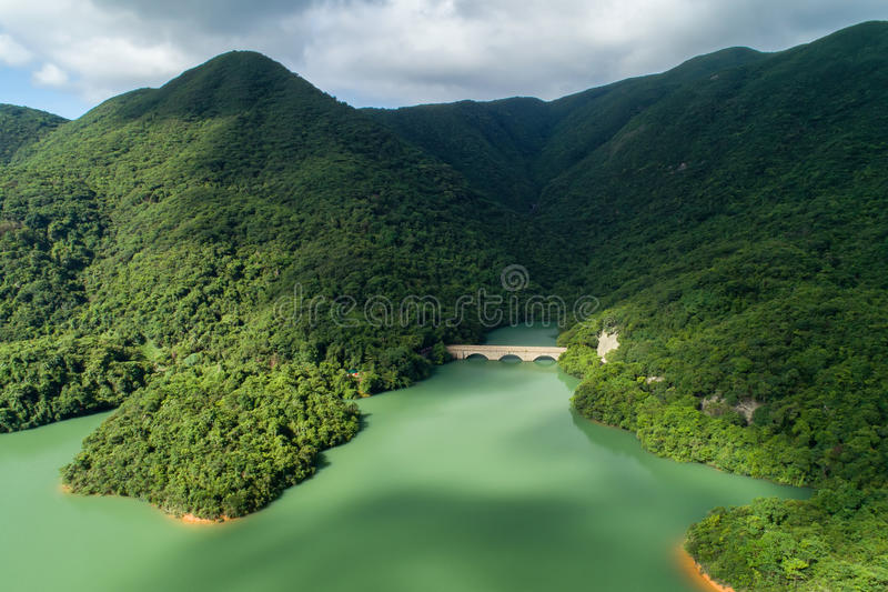 Tai Tam Tuk Reservoir. The construction of Tai Tam Tuk Reservoir was commenced in 1912 and completed in 1918. This is Tai Tam Tuk Reservoir Masonry Bridge royalty free stock image