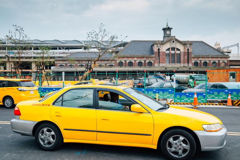 Old Taichung railway station and yellow taxi in Taiwan stock photos