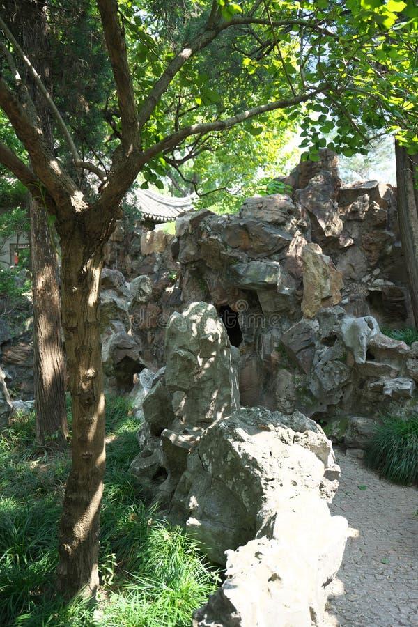 Taihu stones at Lion Forest Garden in Suzhou, China. Suzhou,China-September 17, 2019: Taihu stones at Lion Forest Garden in Suzhou, China stock image