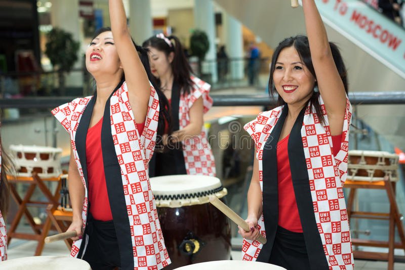 Taiko drummers. Moscow, Russia - March 25, 2017: group of Japanese Taiko drummers girls perform in Kaleidoscope shopping center on the at the opening of a new stock photography