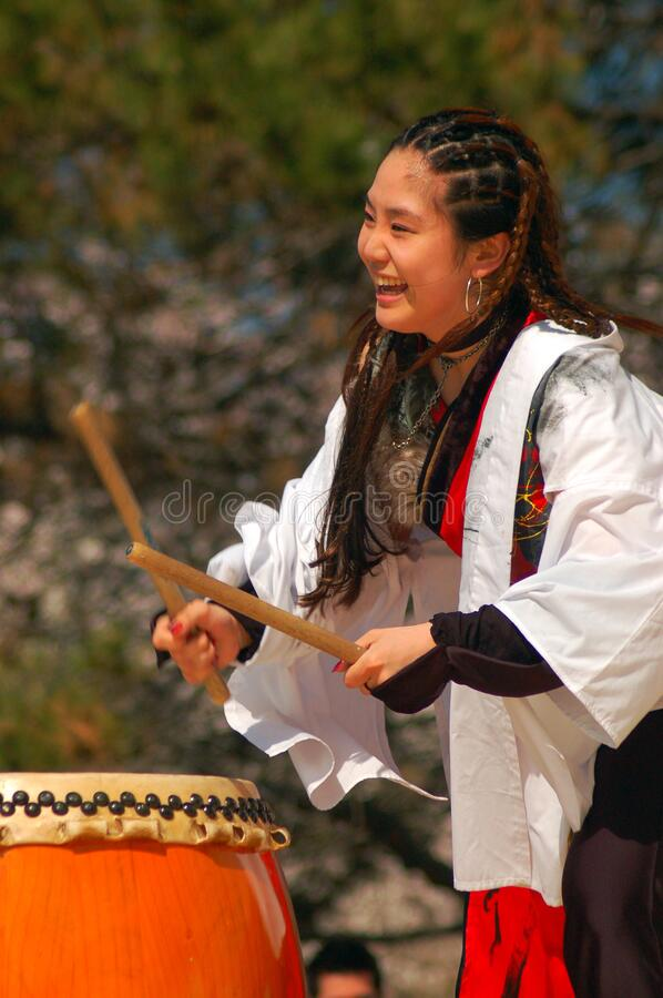 Taiko drumming at a sakura festival. A young adult demonstrates the art of traditional Japanese Taiko drumming at a festival in Belleville, New Jersey stock image
