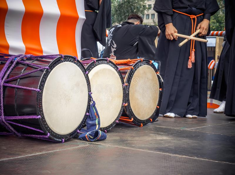 Taiko drums o-kedo are in a row and japanese drummers on the Yagura stage get ready to play. Musical instrument of Asia stock photo