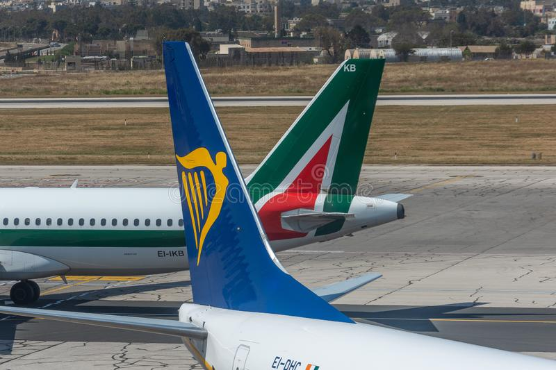 Tail boeing 737-800 Ryanair airlines and airbus a320 Alitalia, airport Luqa Malta, 28 April 2019.  royalty free stock photography