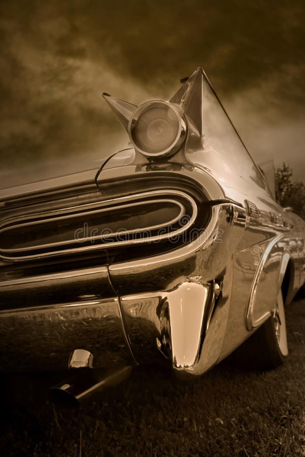 Tail end of classic car. In sepia color tone royalty free stock images