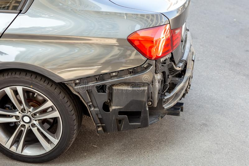 Tail of modern car with removed rear bumper. Vehicle after traffic accident and crash. Transport repair and insurance royalty free stock photos