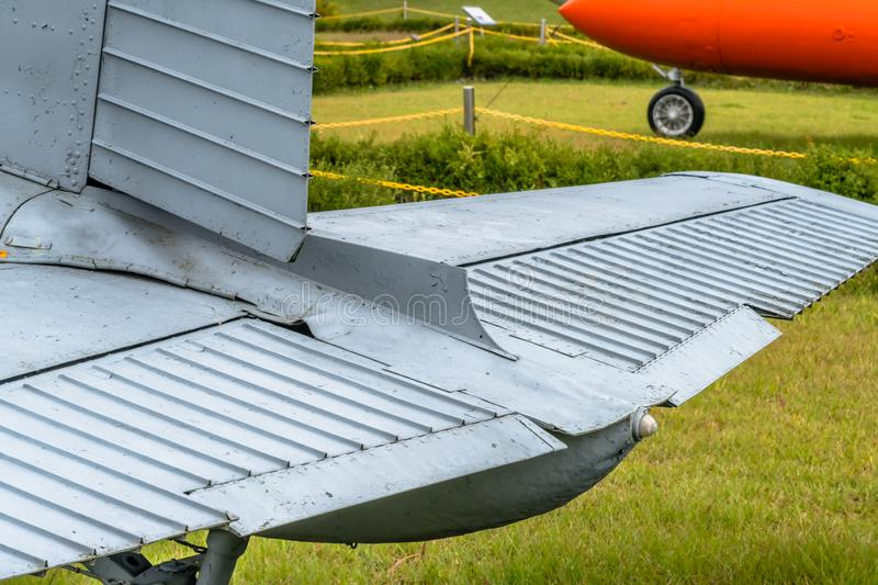 Tail section of old aircraft. Tail section of old De Havilland military trainer aircraft on display in public park royalty free stock image
