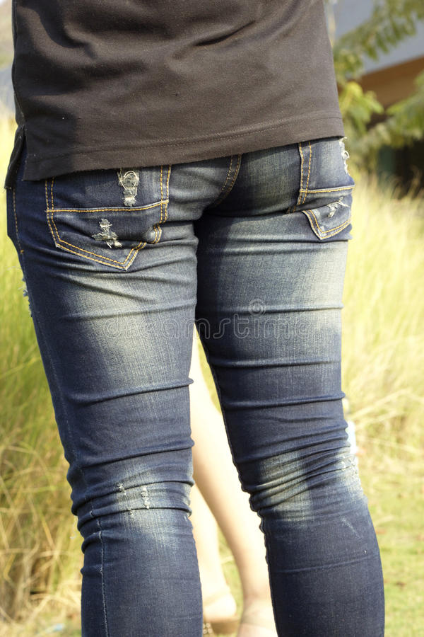 Taille avec des jeans image stock