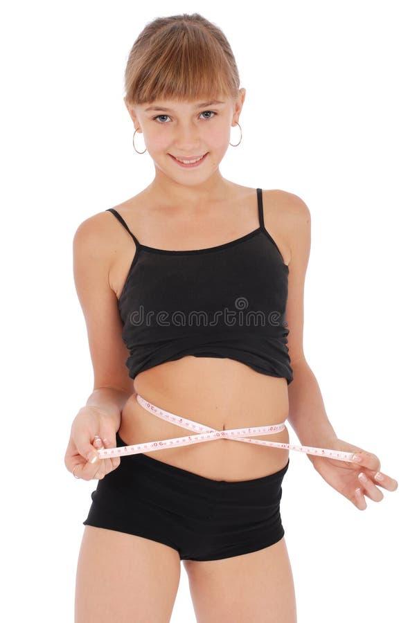 Taille de mesure de fille avec la mesure de bande image libre de droits
