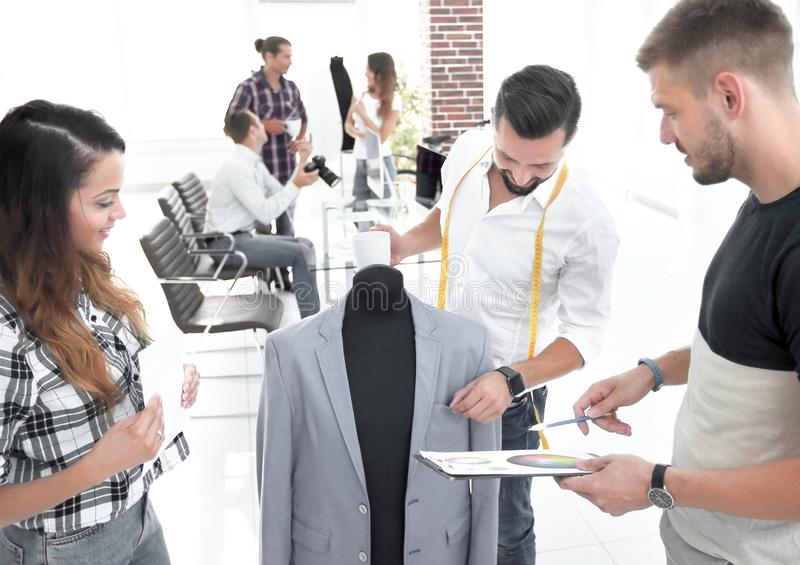 Tailor and designers to discuss men`s suit stock photo
