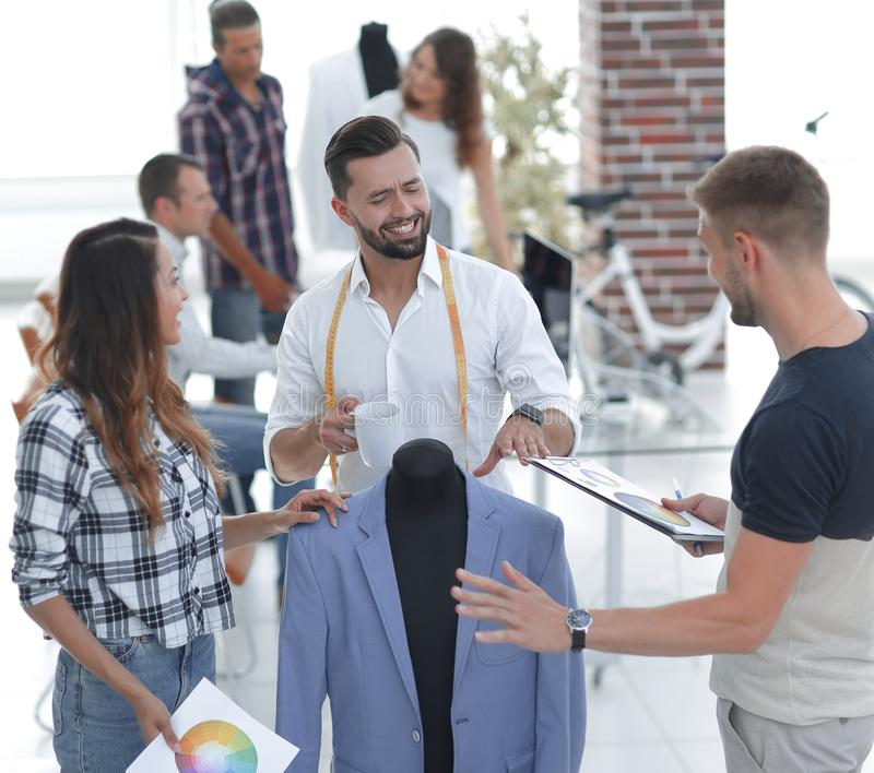 Tailor and designers to discuss men`s suit royalty free stock photography