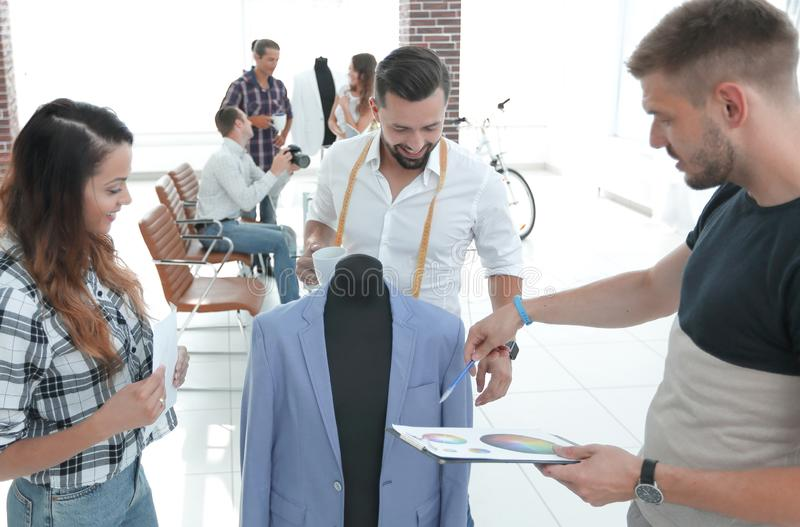 Tailor and designers to discuss men`s suit stock image
