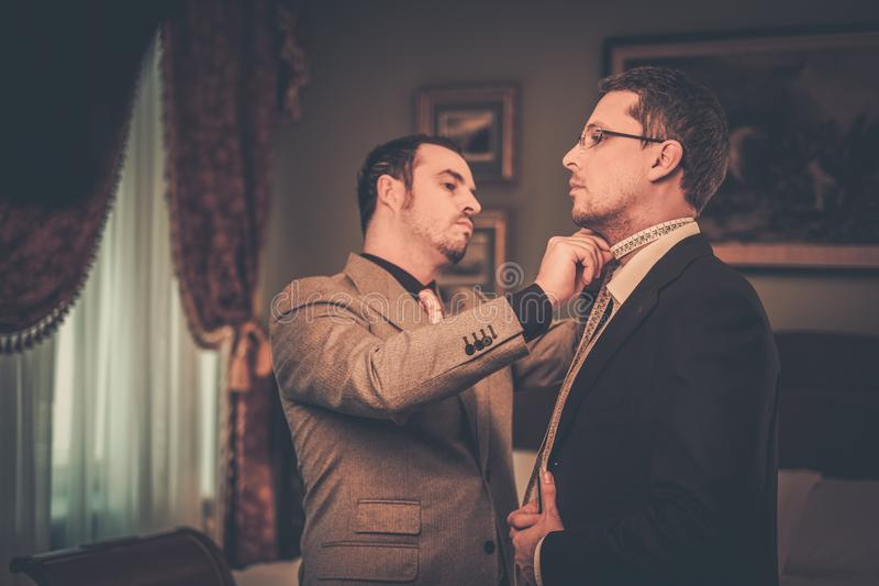 Tailor and his client stock image
