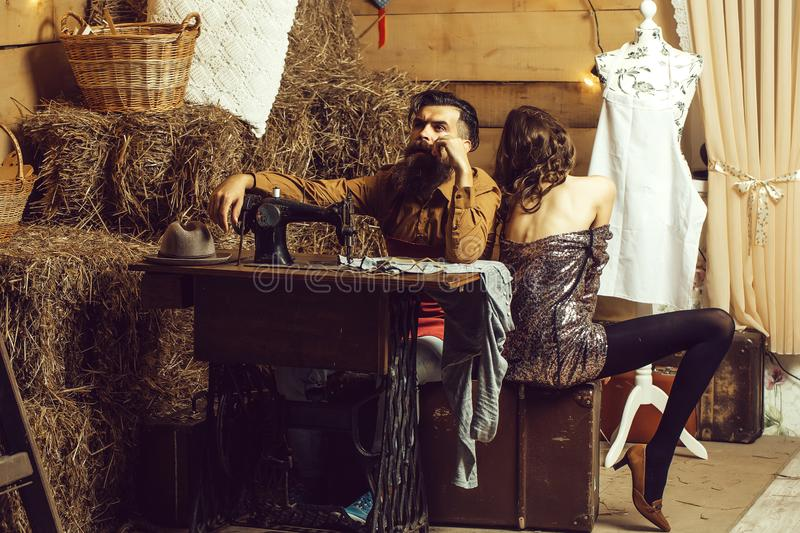 Tailor man and pretty girl stock photo