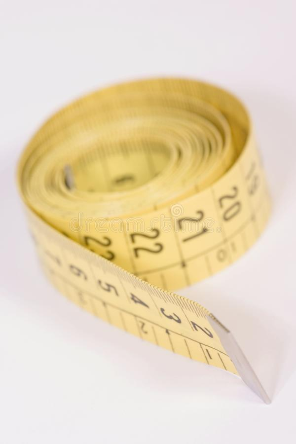 Download Tailor's measuring tape stock photo. Image of obesity - 1093112