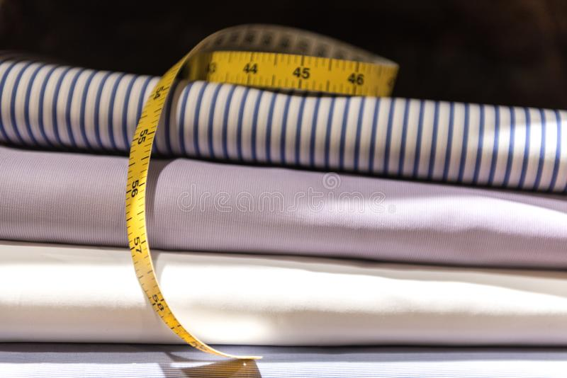Tailor`s Tape Measure and Fabric Swatches stock photos