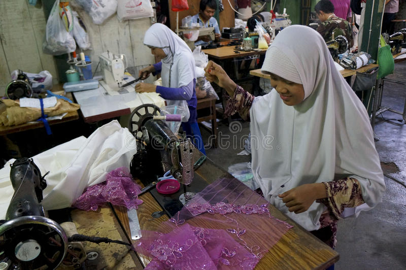 Tailor. S are making garments in a factory in the city of Solo, Central Java, Indonesia royalty free stock photos