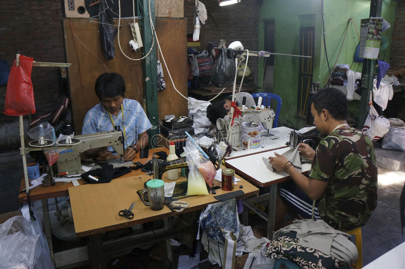 Tailor. S are making garments in a factory in the city of Solo, Central Java, Indonesia stock photography