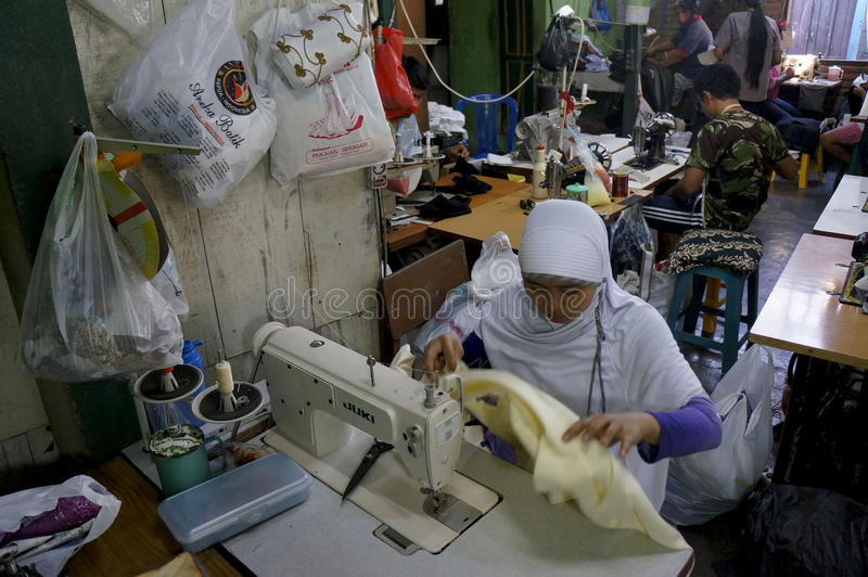 Tailor. S are making garments in a factory in the city of Solo, Central Java, Indonesia stock photos