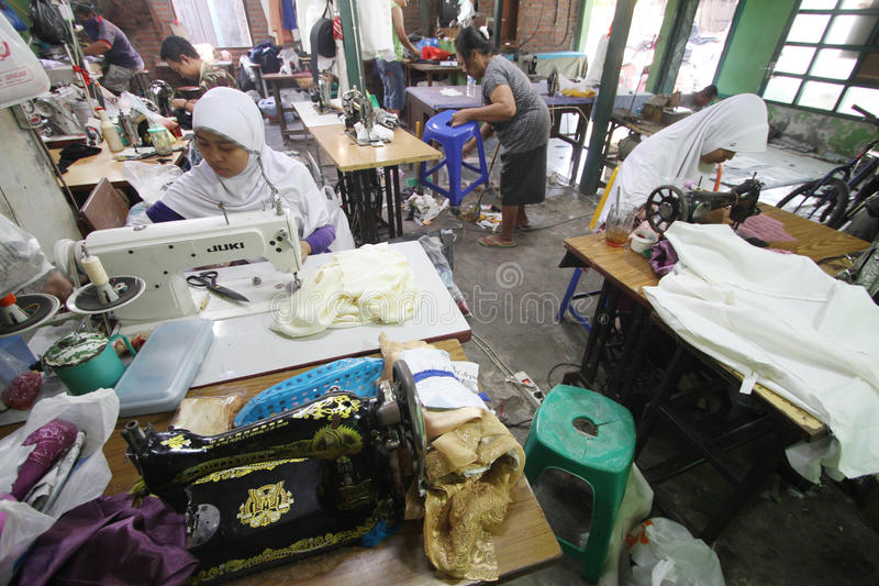 Tailor. Women sew a cloth at a factory in solo, central java, indonesia royalty free stock image