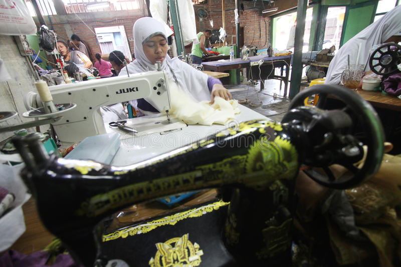 Tailor. Women sew a cloth at a factory in solo, central java, indonesia royalty free stock photos