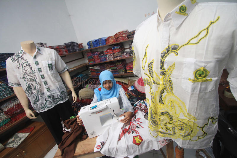 Tailor. Women sew a cloth at a factory in solo, central java, indonesia stock images