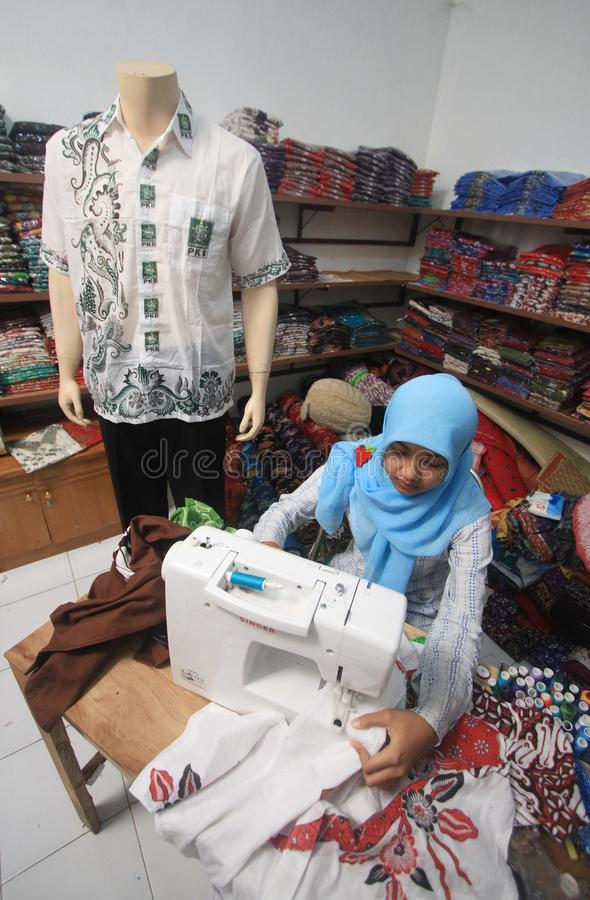 Tailor. Women sew a cloth at a factory in solo, central java, indonesia stock photo