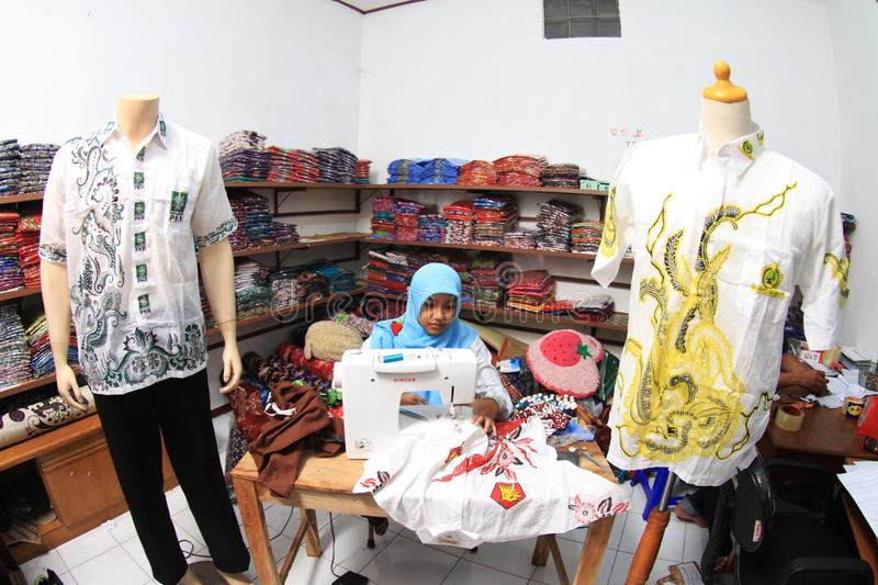 Tailor. Women sew a cloth at a factory in solo, central java, indonesia royalty free stock photo