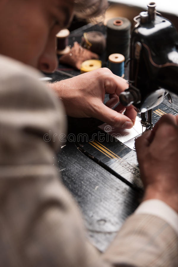 Download Tailor at work. stock image. Image of work, shop, concentrated - 33941457