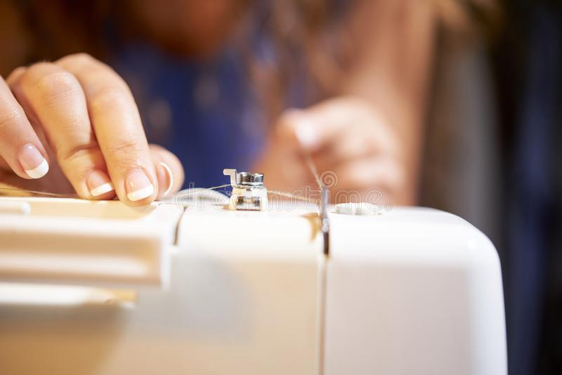 Tailor working on sewing machine stock photos