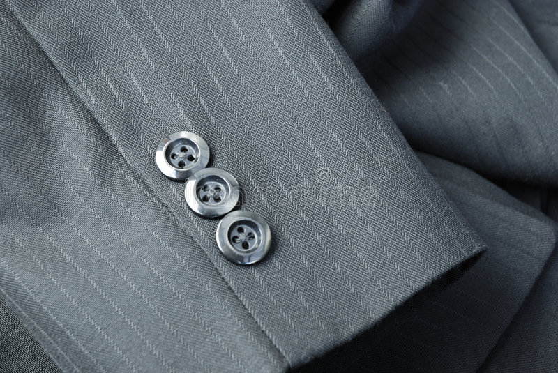 Tailored suit. Cuff of a bespoke tailored pinstripe suit royalty free stock photo