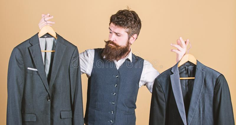 Tailored suit concept. Designing made to measure suit. Custom made suit. Man bearded fashion couturier tailor. Elegant stock photography