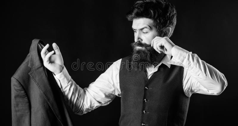 Tailoring and clothes design. Custom made to measure. Designing made to measure suit. Custom made suit. Man bearded royalty free stock photo