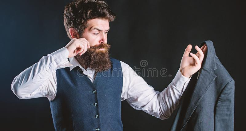 Tailoring and clothes design. Custom made to measure. Designing made to measure suit. Custom made suit. Man bearded stock image