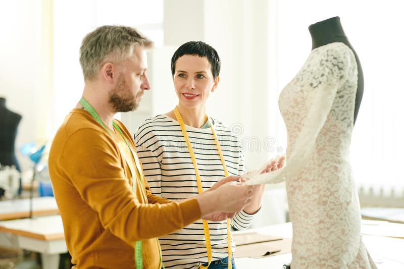 Tailors consulting royalty free stock photography